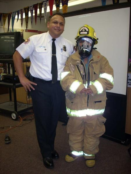 Student in fireman gear with Fire Marshall