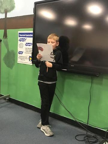 student reading poetry in the Media Center