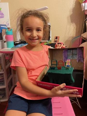 Olivia holding Goldilocks scene in box