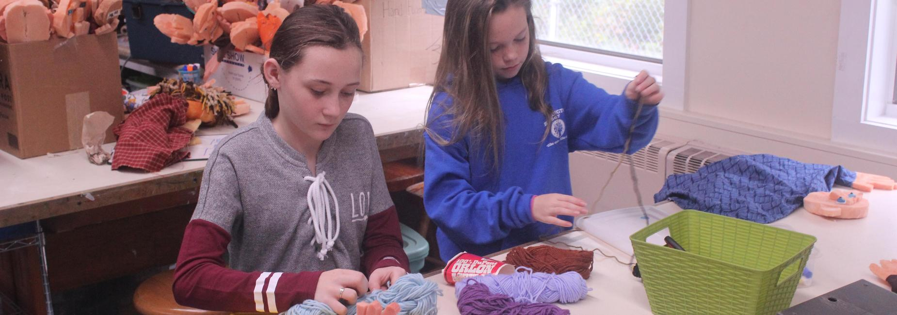 students crafting with yarn