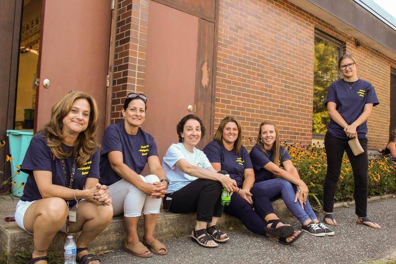 Teachers sitting outside Andrew Avenue