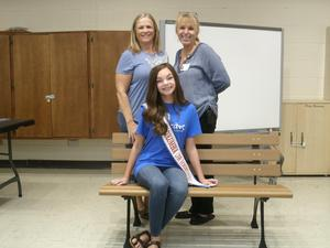 Allie Ingram, Dr. Hall, and Mrs. Deaton at buddy bench.