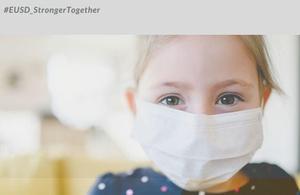 female child wearing face mask
