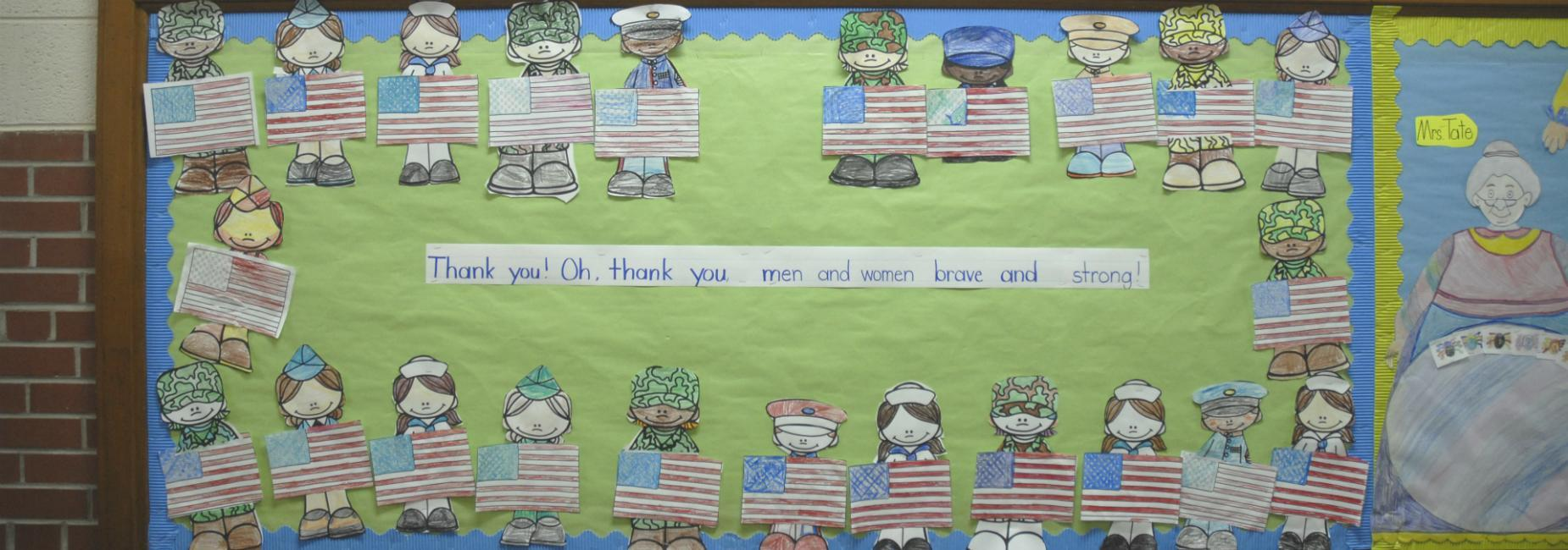 Bulletin board thanking American service men and women for being brave and strong