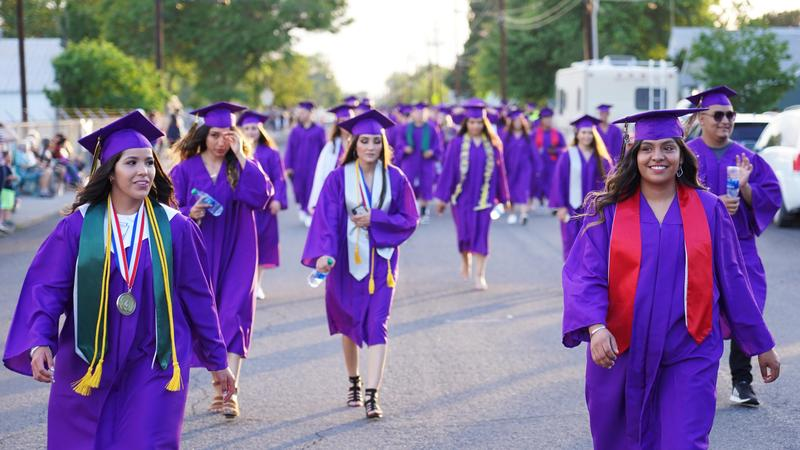 Students wearing their caps and gowns.