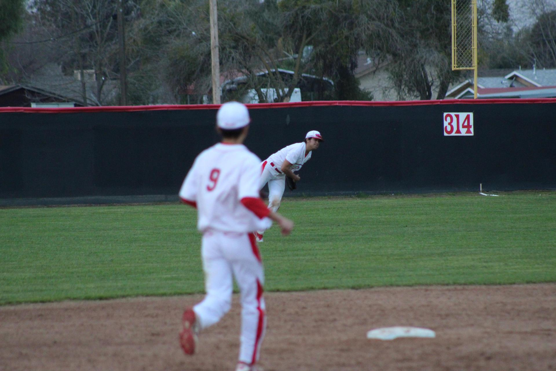 Varsity baseball players in action against Golden West