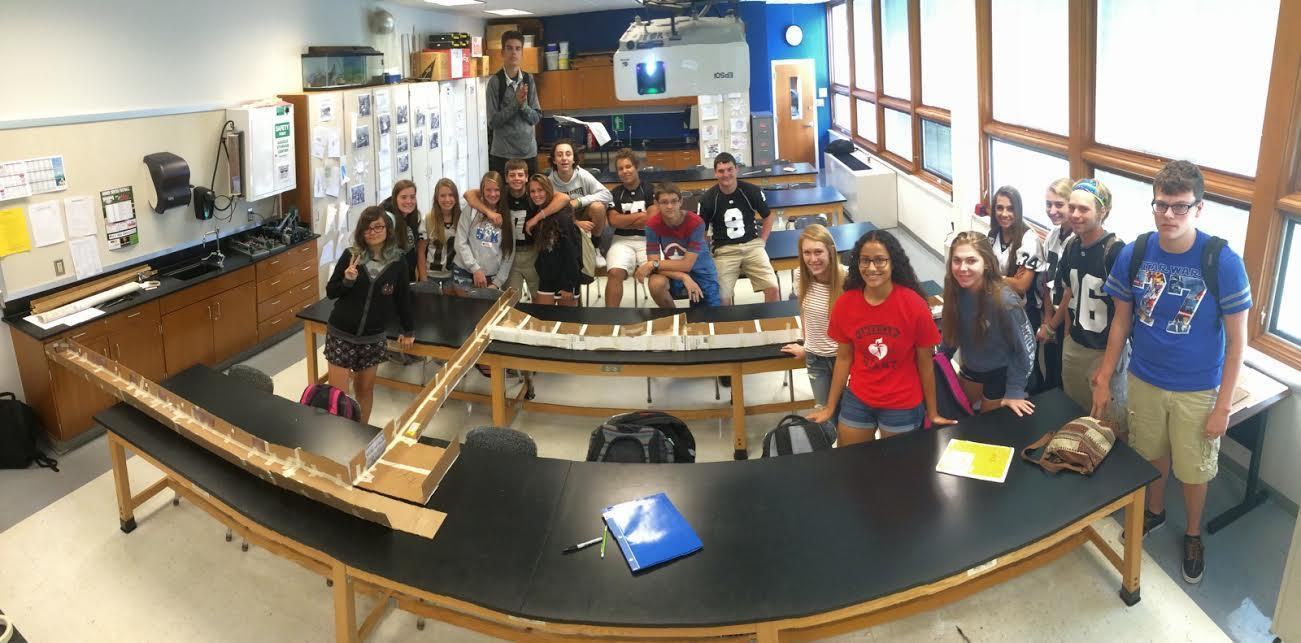 students working building a model of school