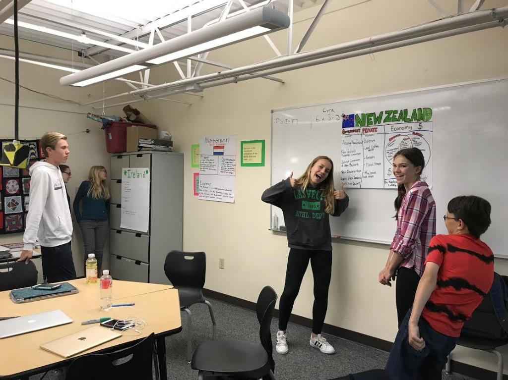 Students in Business Principles class present about the economies in countries around the world.