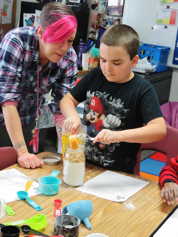 Students prepared ingredients to make holiday cookies.