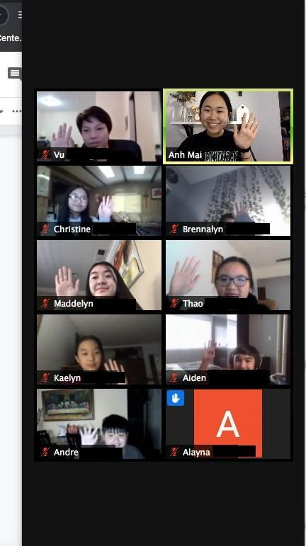A screenshot of Ms. Mai and several students waving to the camera on a Zoom call.