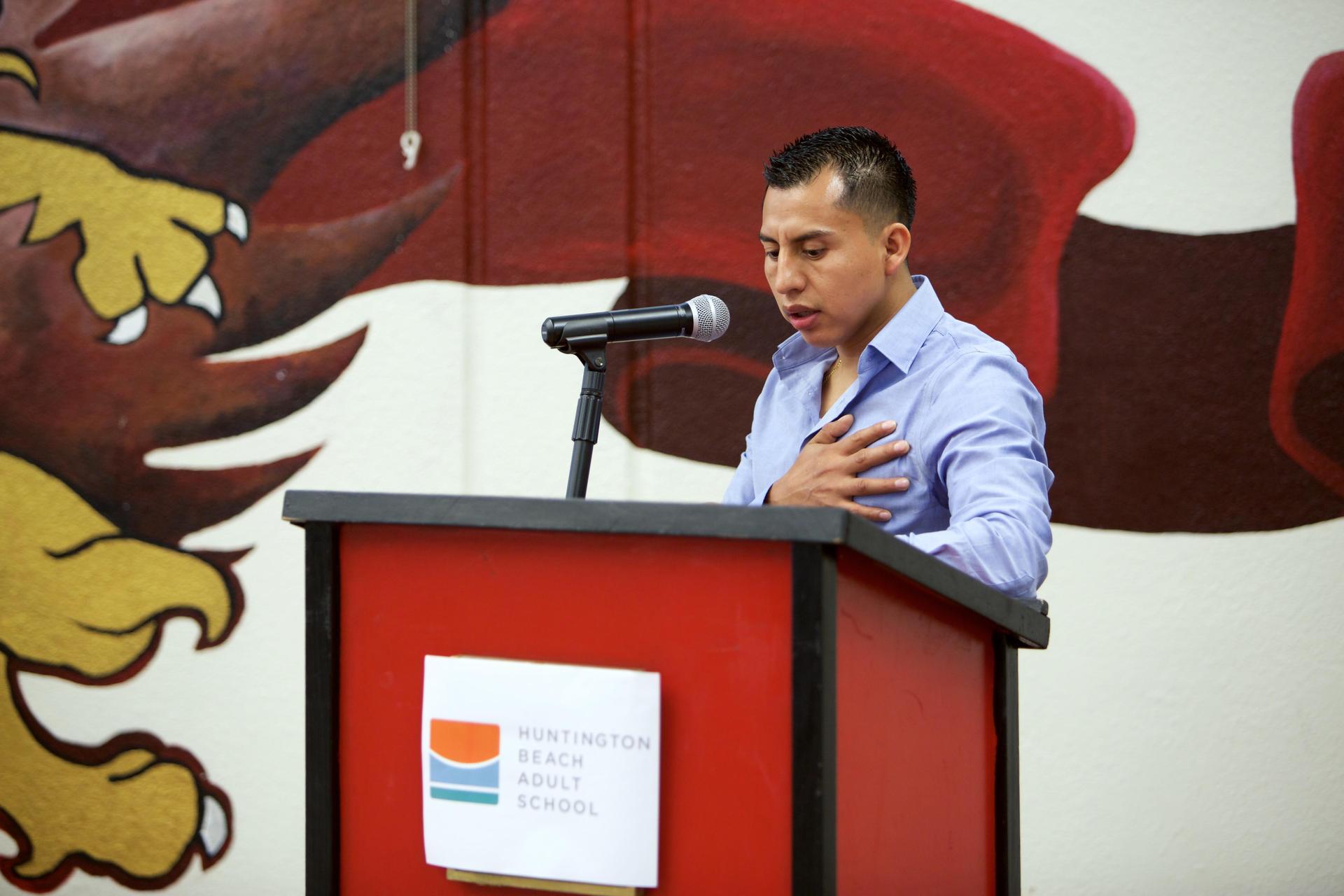 Gerardio Lopez leads the Pledge of Allegiance
