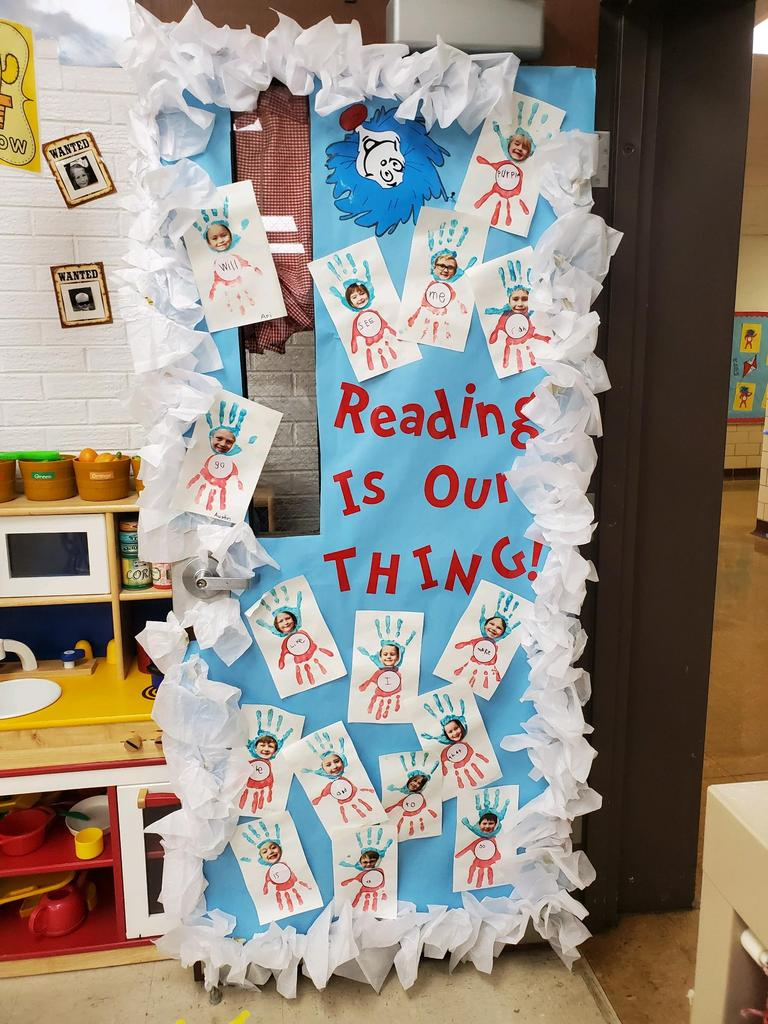 """Reading is our Thing"" door decoration"