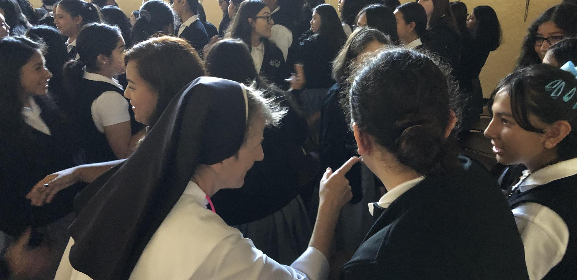 students and faculty at mass