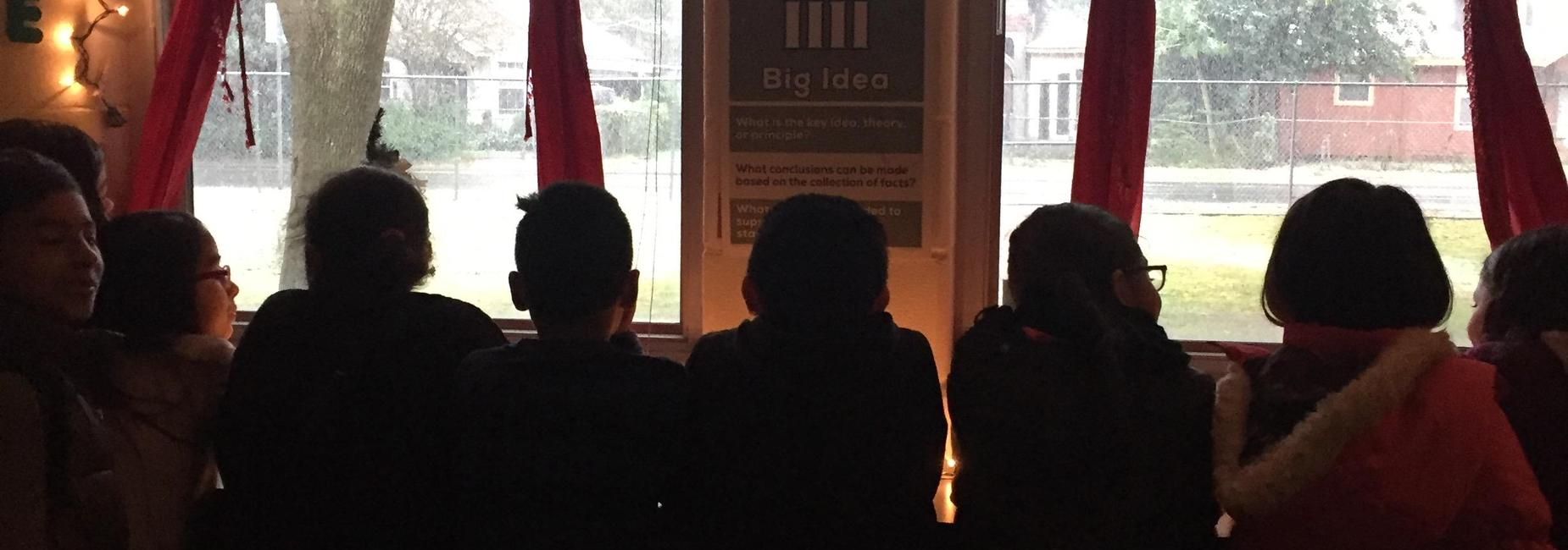 Children watching through window