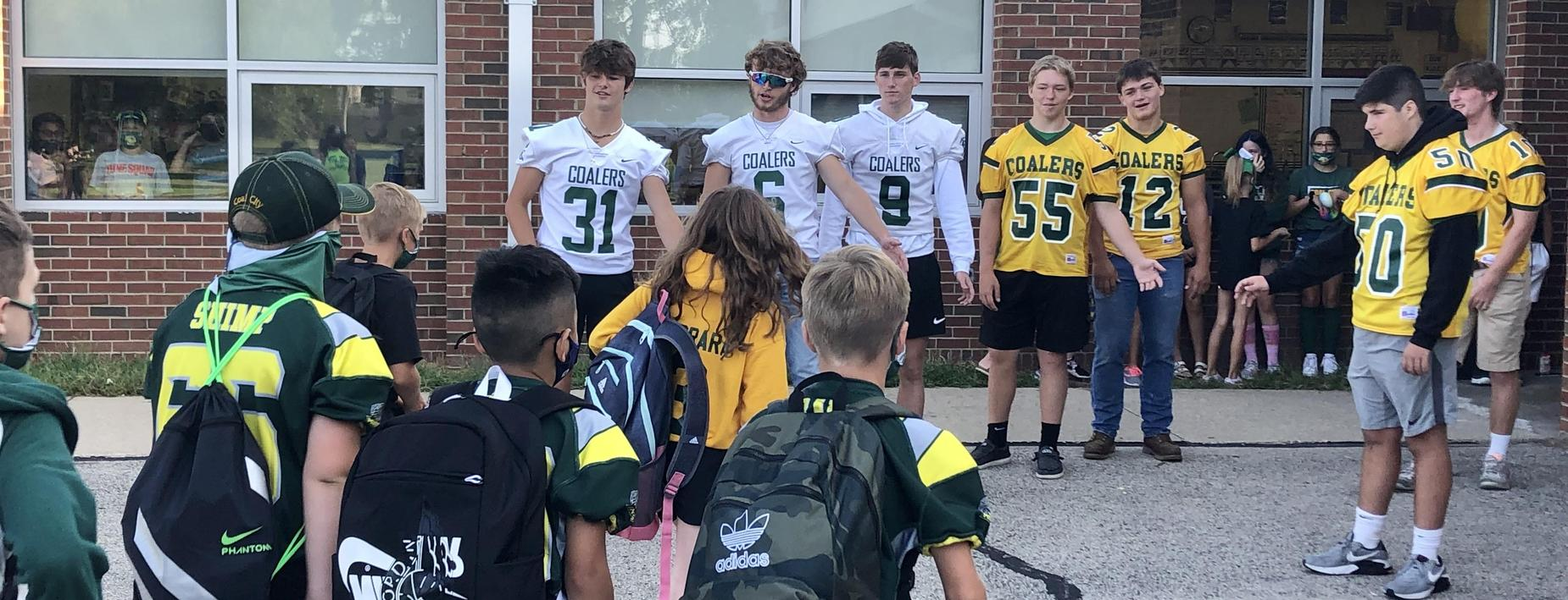 Football players visit the IS