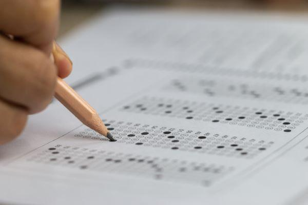 Student filling bubbles on answer sheet of an exam