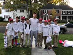 A group of EIS students dress up as Boys Lacrosse Coach Tuohy for Halloween...