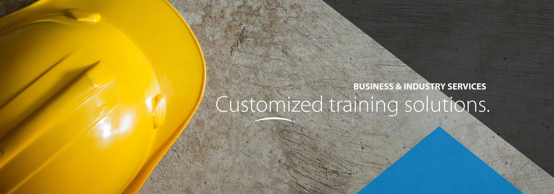 Image of a hard hat with text that reads: Business & Industry Services, Customized training solutions.