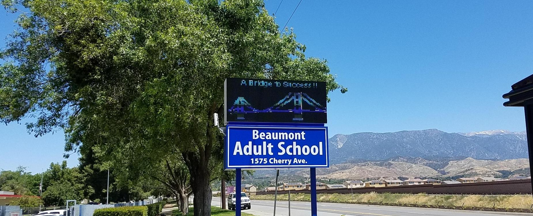 Photo of Beaumont Adult School marquee sign with mountains in background