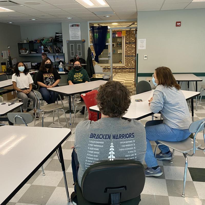 students talking to teachers