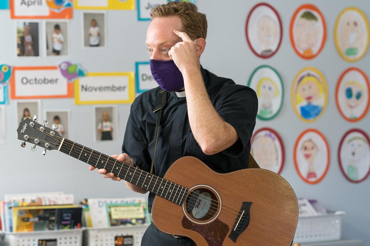 St. Timothy's School chaplain plays guitar for kindergarten students