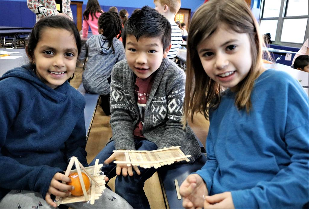 Photo of three Tamaques 2nd graders smiling as they participate in design challenge during STEAM Day.