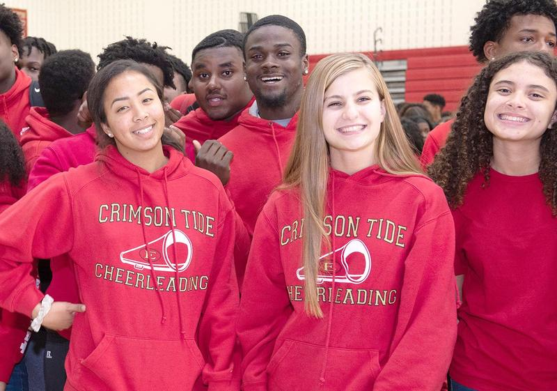 A group of students wearing red Crimson Tide sweatshirts on Brandon Conde Day