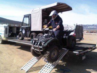Driving Outrider ATV off trailer.