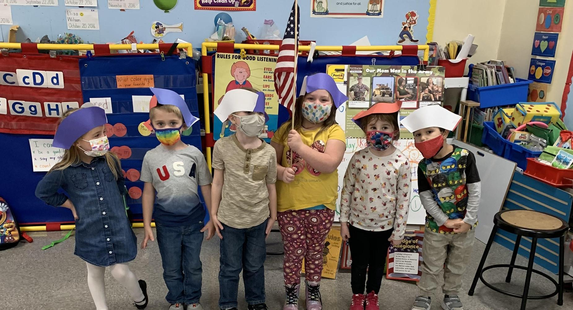 students in hats with american flag
