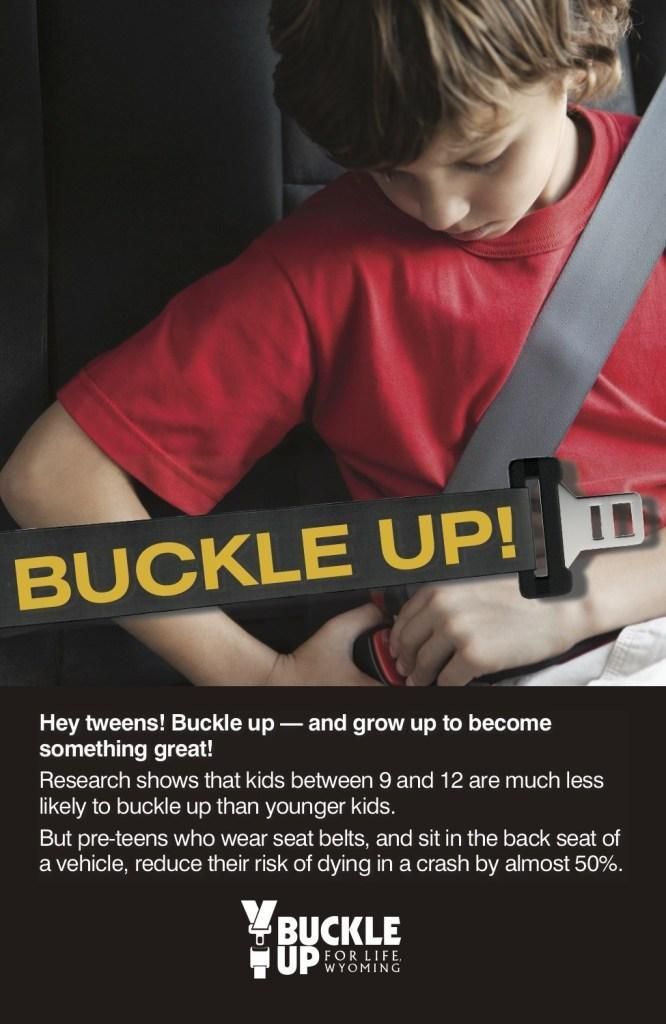 Boy buckling his seatbelt in Buckle Up for Life Wyoming flyer