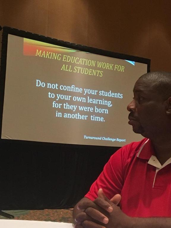 GOA Social Studies Teacher, Norman Carter, contemplating strategies to help students achieve academic excellence.