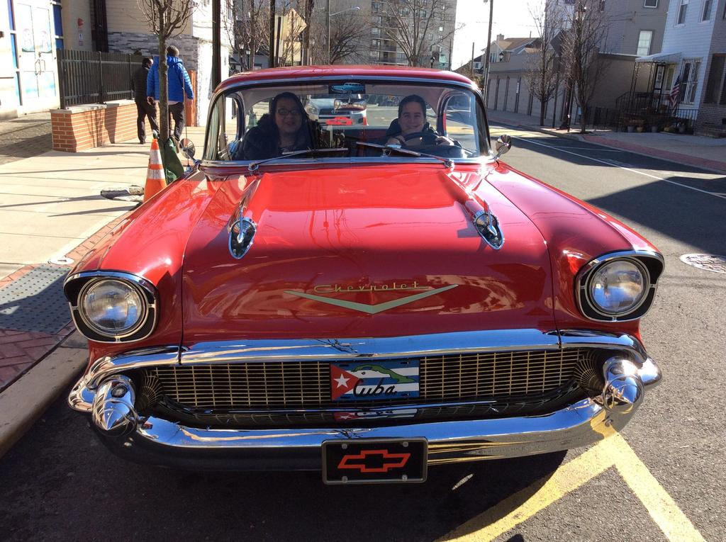 Mrs. Hurtado in the drivers seat and Ms. Menjivar in the passenger seat of the 57 Chevy