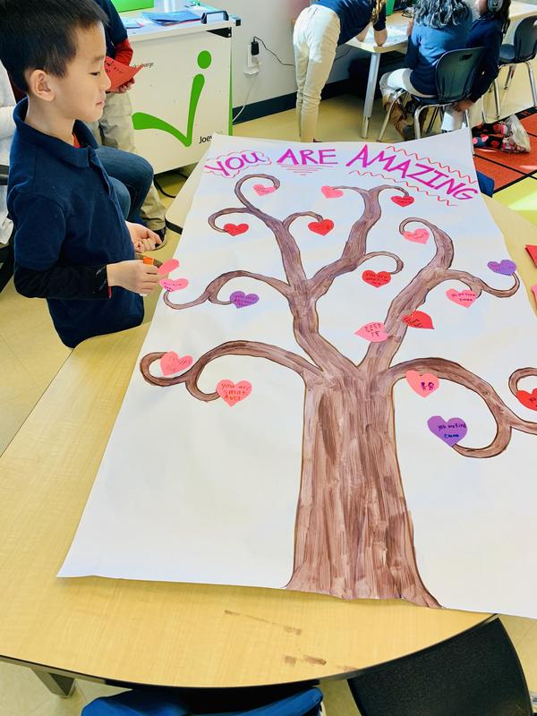 Students create a poster for a sick classmate.