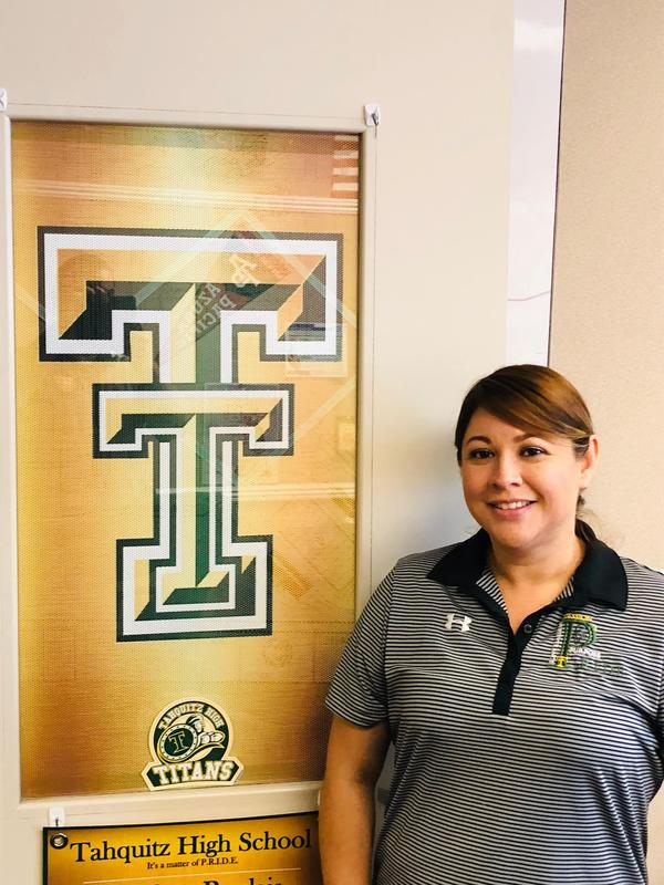 Esmeralda Chavez standing in front of a Tahquitz Titans window covering.