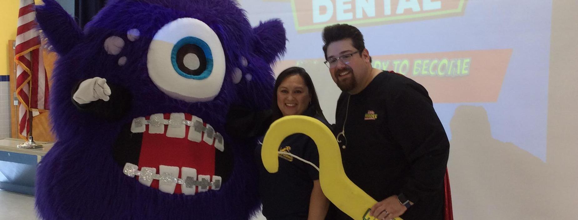 Nurse with dental staff and mascot