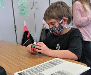 Lee students learn to solve the Rubik's  Cube.