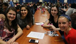 Photo of four French Club members at the celebration of cultural diversity at WHS on May 2.