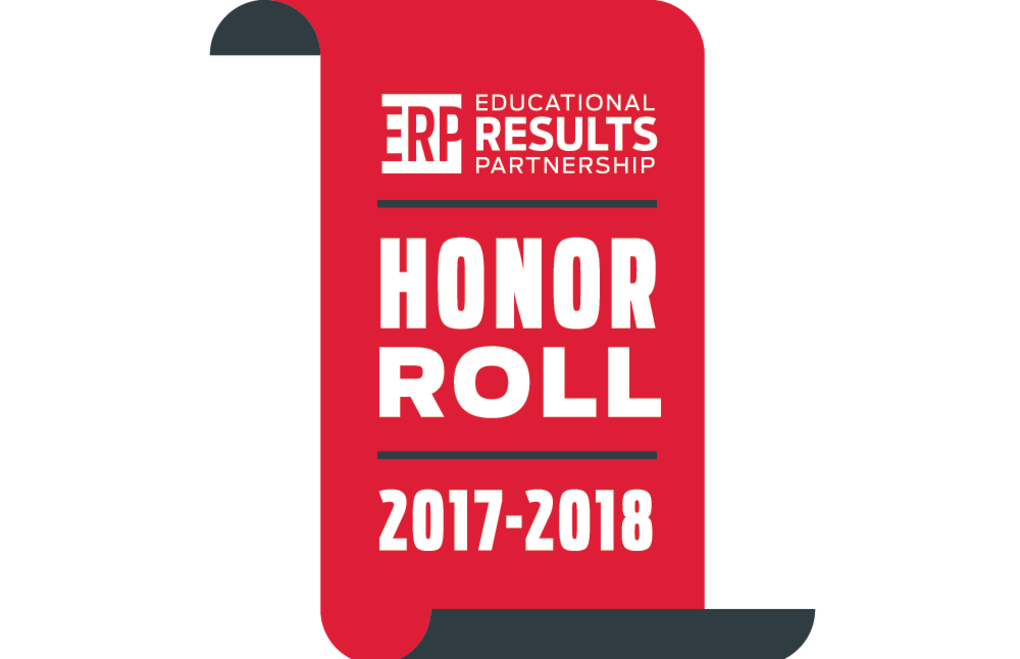The picture shows Anderson being recognized as an honor roll school by the Educational Results Partnership.