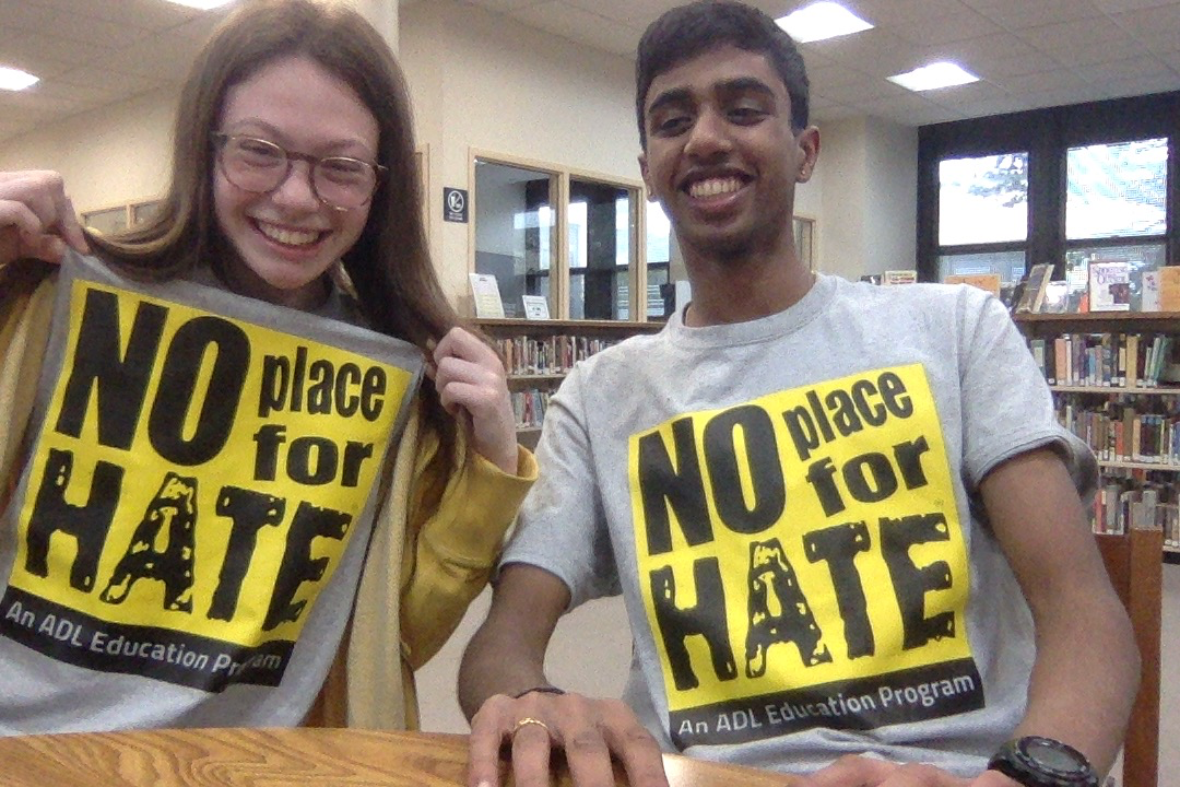 Two students with NPFH shirts on