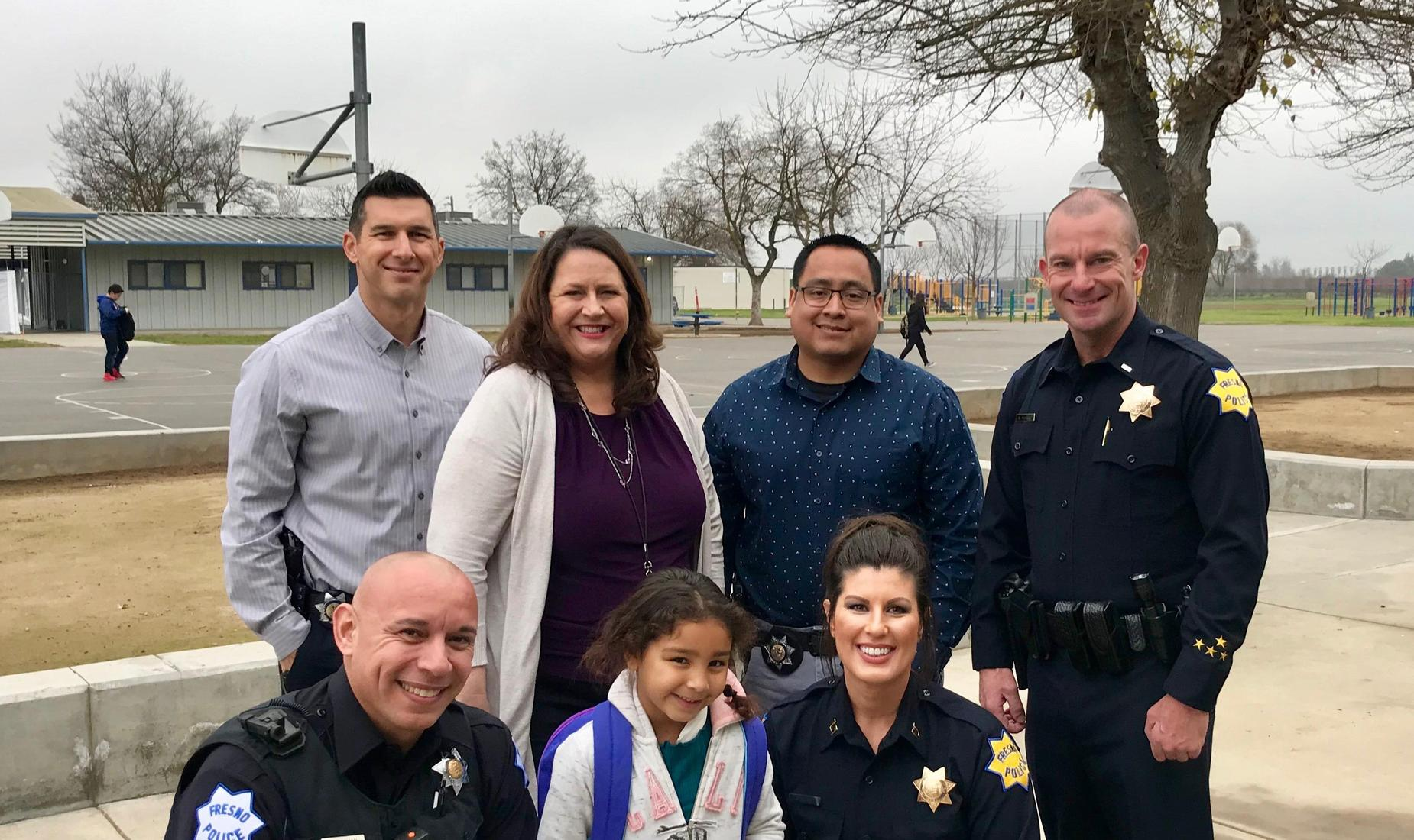 Madison staff with members of the Fresno Police Department