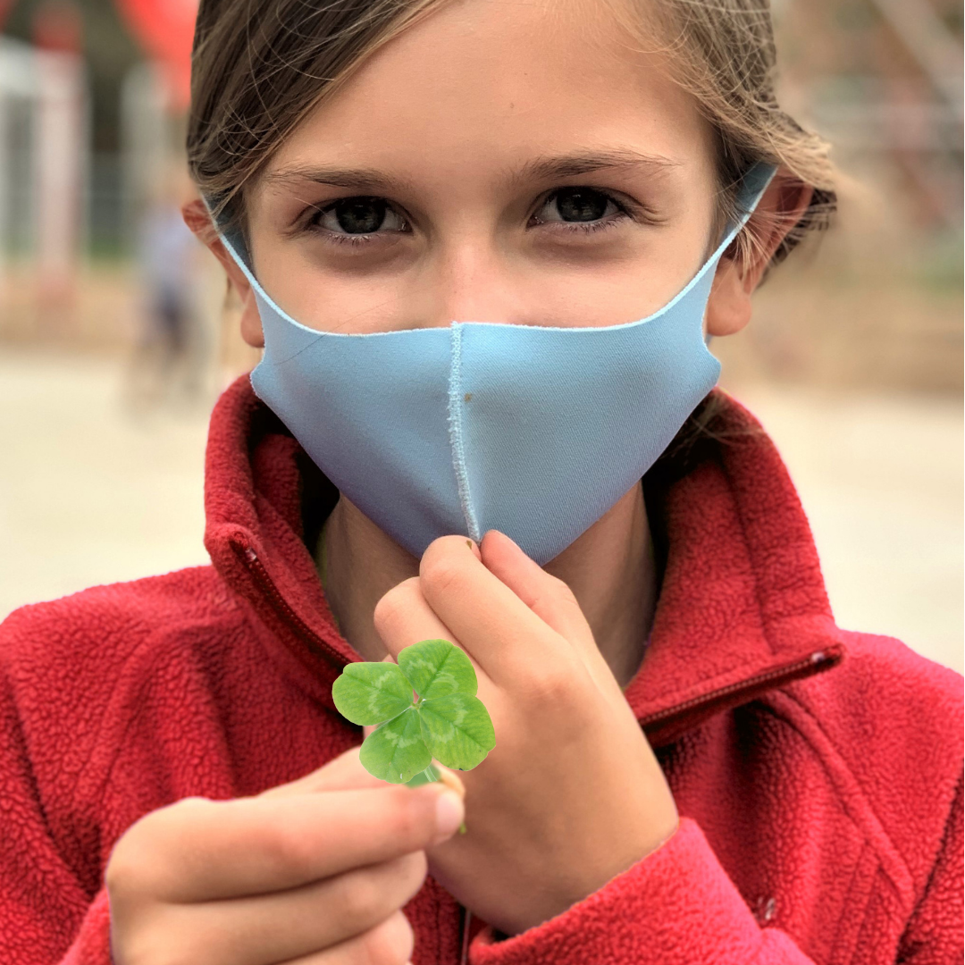 Student with four leaf clover