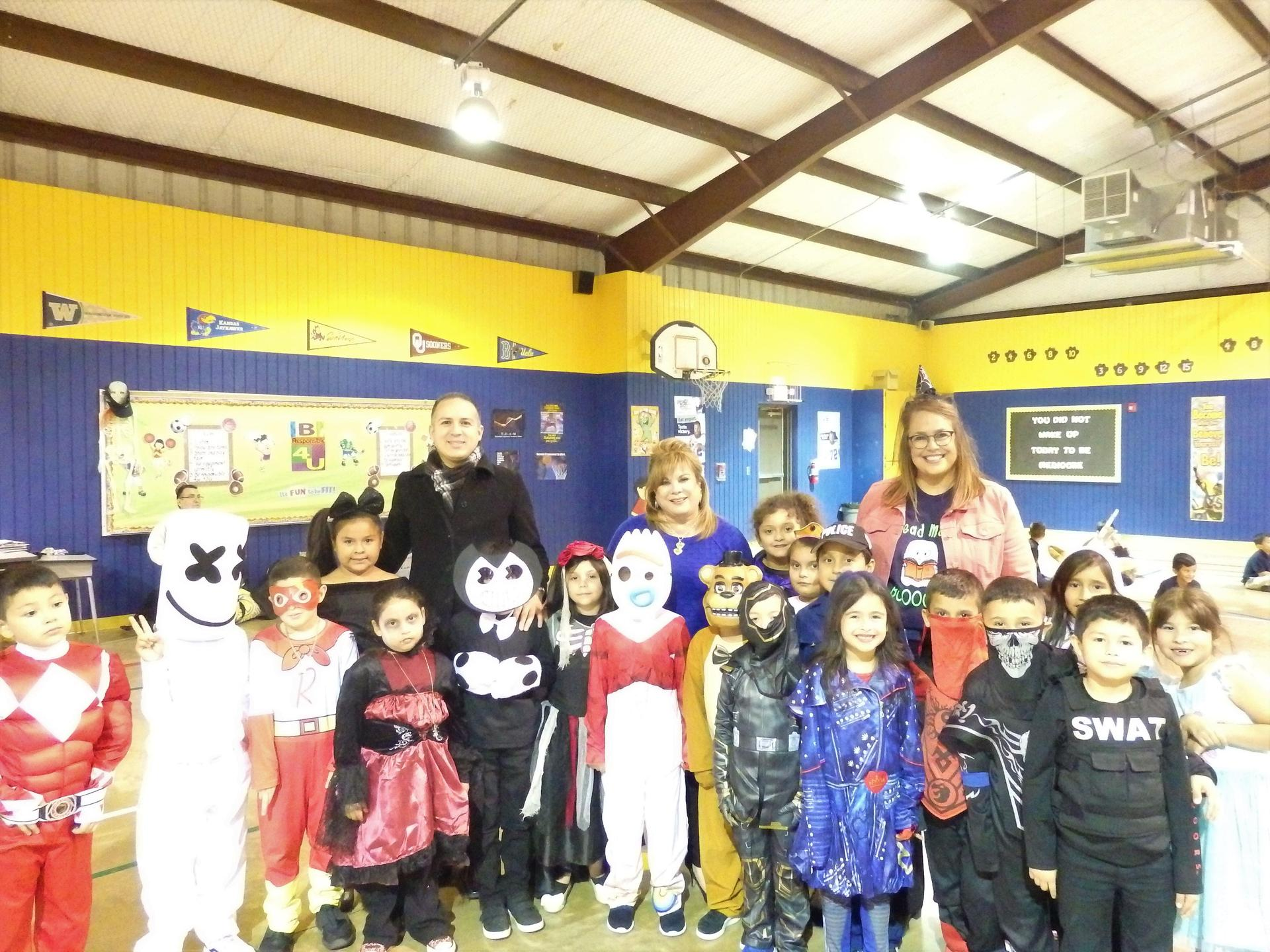 Guerra Admin and students in halloween costumes