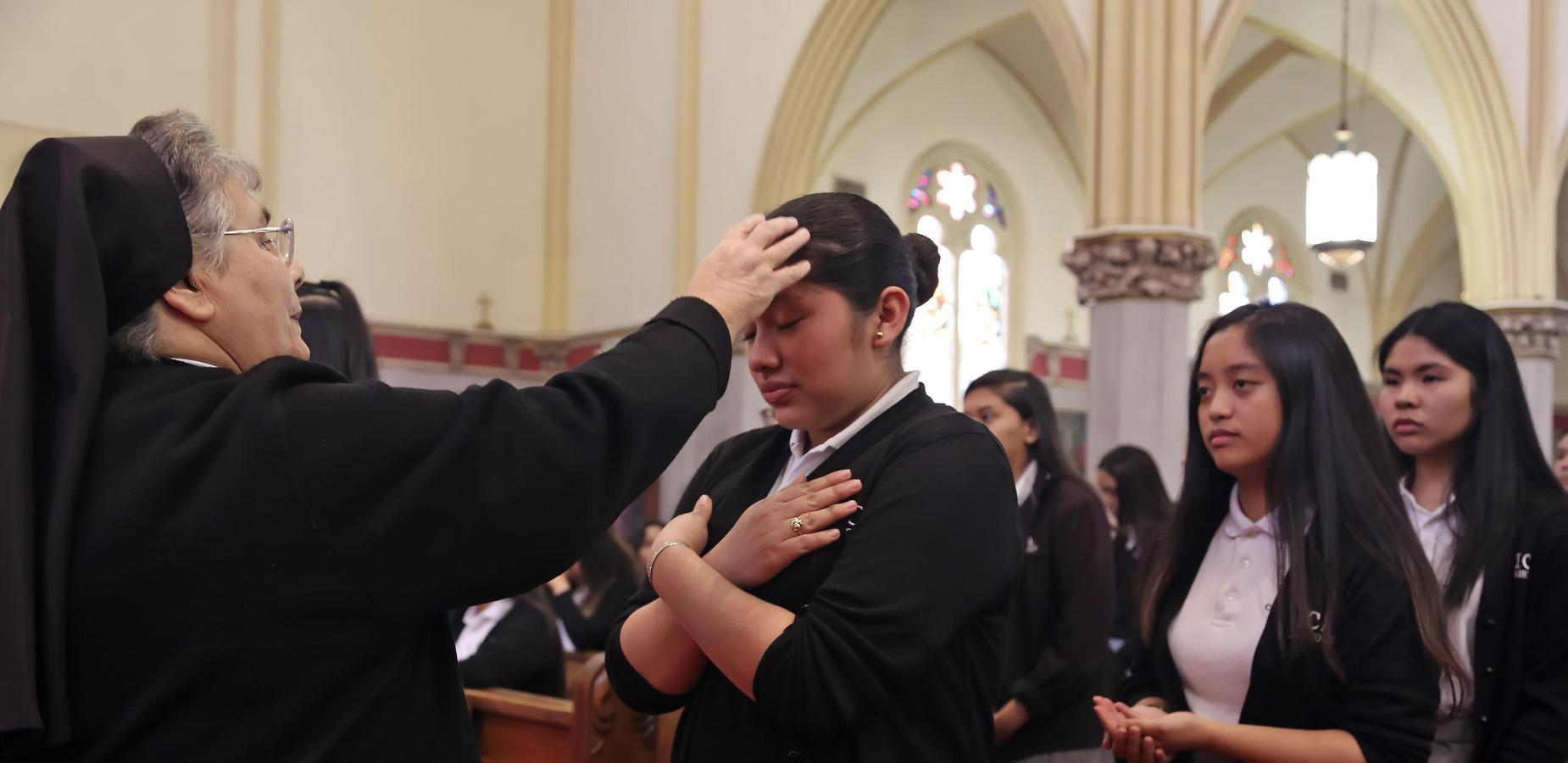 S. Diane blessing Junior at Junior Mass (Junior Ring Ceremony)