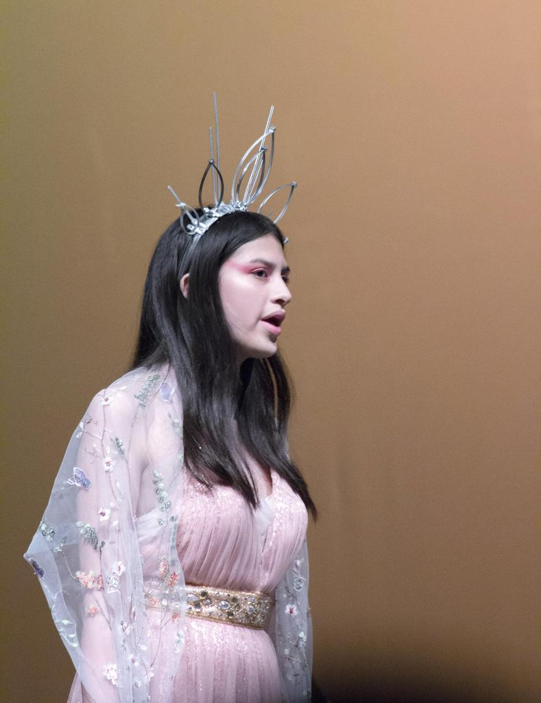 Wearing an elaborate tiara, Vanessa Pineda plays Erzulie, the Goddess of Love