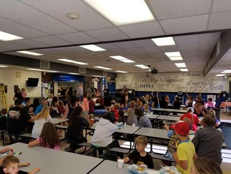Parents and students enjoying the Baked Potato Bar dinner