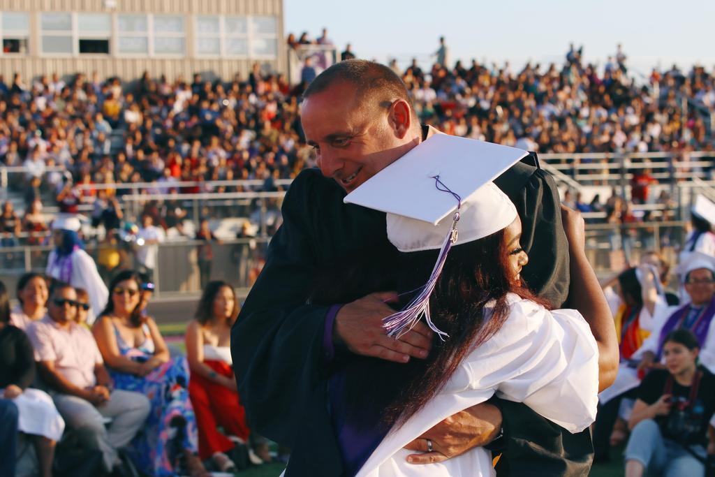 Principal Swanson congratulates graduate