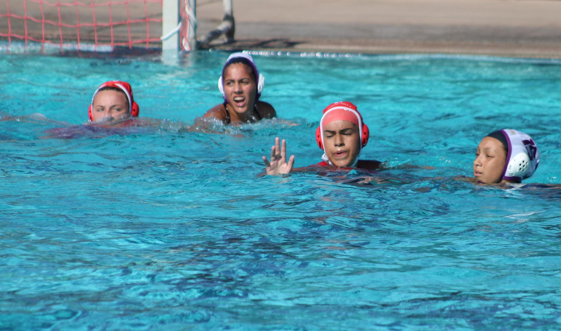 girls playing water polo against Livingston