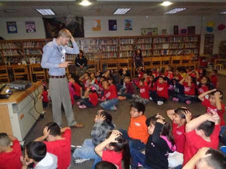 Author presenting to students