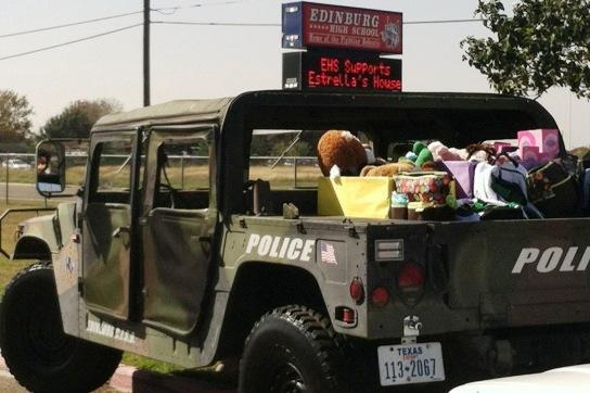 Image of cop car transporting Christmas gifts