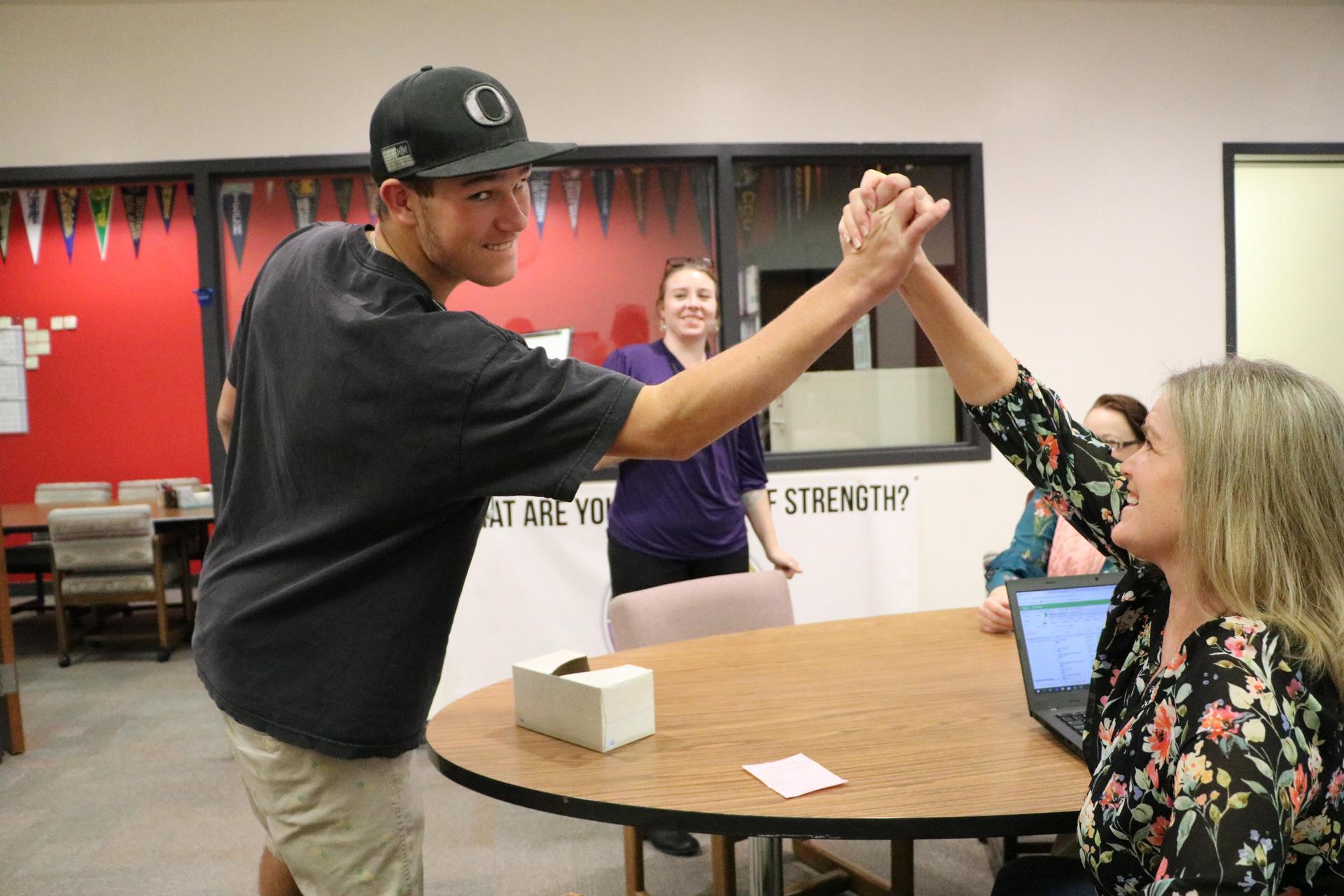 Deb congratulating a student